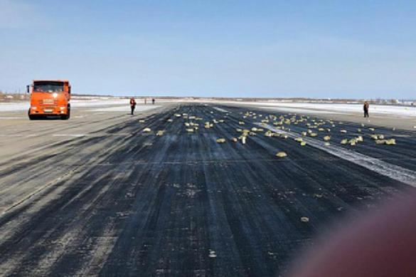Russian plane carrying too much gold falls apart during takeoff scattering gold bars. 62150.jpeg