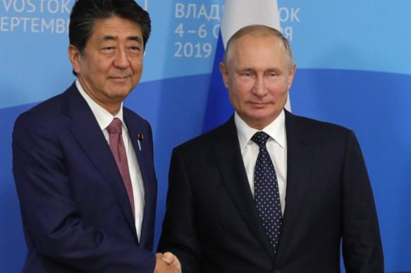 Japan's Shinzo Abe to Putin: Let's conclude peace treaty. 63836.jpeg