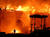Ashes by Kremlin: historic building on fire