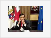 Georgian President Saakashvili eats his tie on TV live (video)