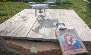 Ukrainians mount icon on drone to bless their village from above