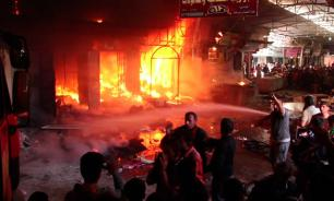 In Mosul market on fire because of shelling. Video