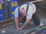 Athlete sets new world record pulling 12 freight cars