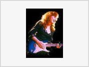 Bonnie Raitt joins the ranks of entertainers who are critical of George Bush