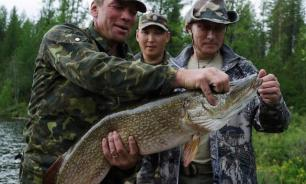 Putin chases pikes in ice-cold Siberian lakes