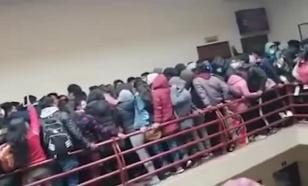 Seven students fall to their deaths as railing collapses at university