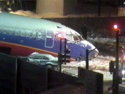 Boeing 737 slides off runway into busy street, smashing cars