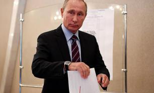 Putin wins election in landslide victory with rivals gaining just 15% and lower
