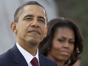Republicans desperately try to paint Obama and his wife black
