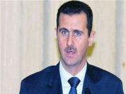 Assad warns west