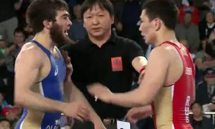 Riot police interfere to pull apart fighting athletes at Russian Wrestling Championship