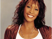 Whitney Houston travels with a big company