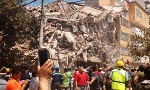 Girl found alive under school rubble in Mexico. Death toll climbs on
