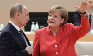 Putin and Merkel determined to continue cooperation after Bundestag elections