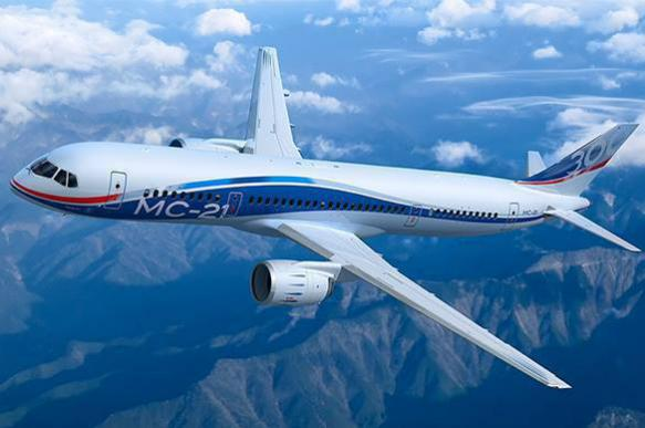 Russia's new MC-21 passenger plane goes on maiden flight