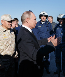 Russian servicemen leave Syria as victors