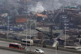 Китайские власти сообщают об увеличении числао погибших во время катастрофы в промышленном порту Тяньцзинь