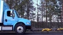 Собаки-роботы перетаскивают огромный грузовик