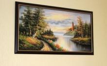 Как правильно вешать картины в доме